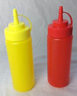 Plain mustard and ketchup bottles.
