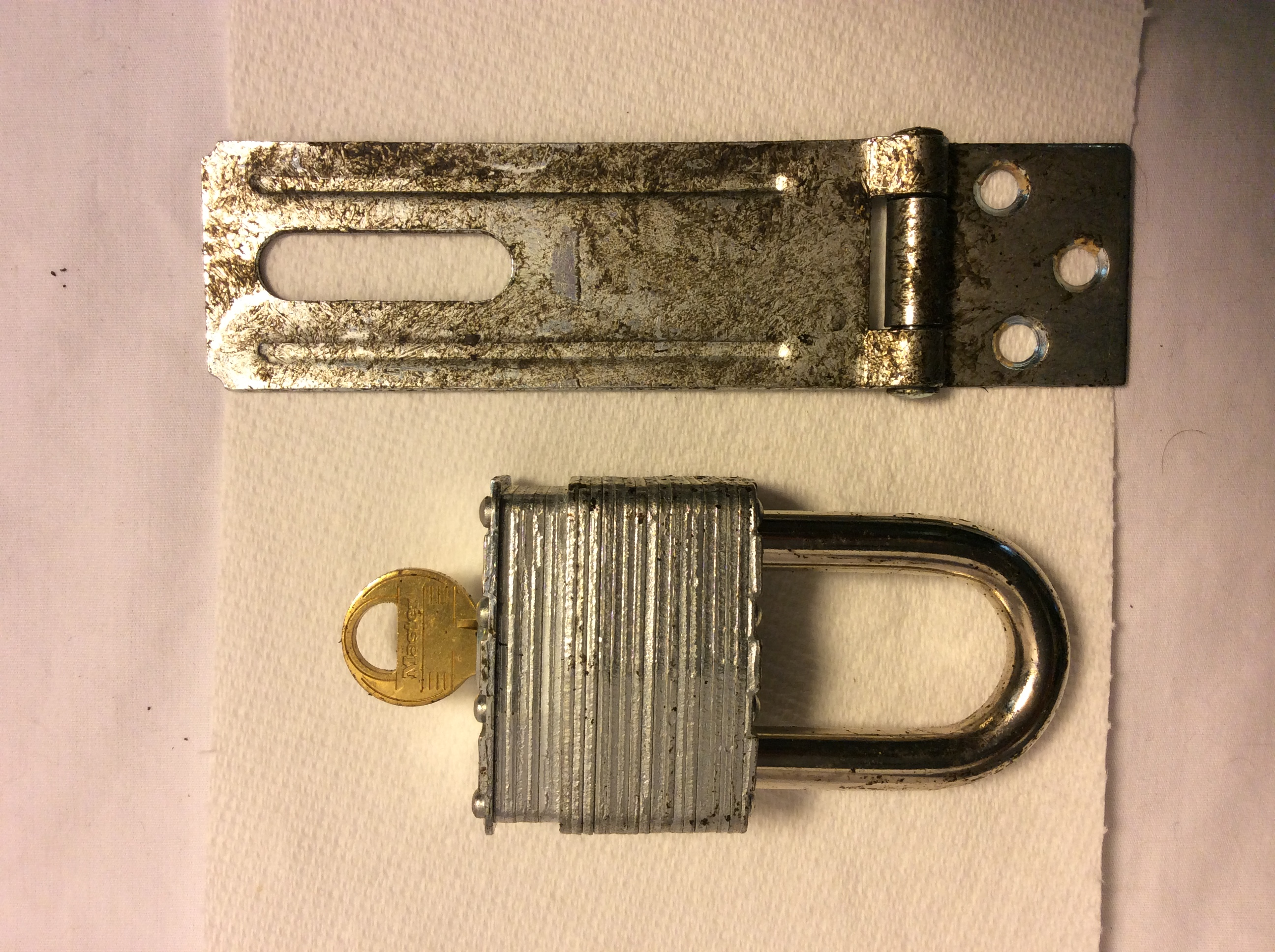 aged silver padlock with extra latches