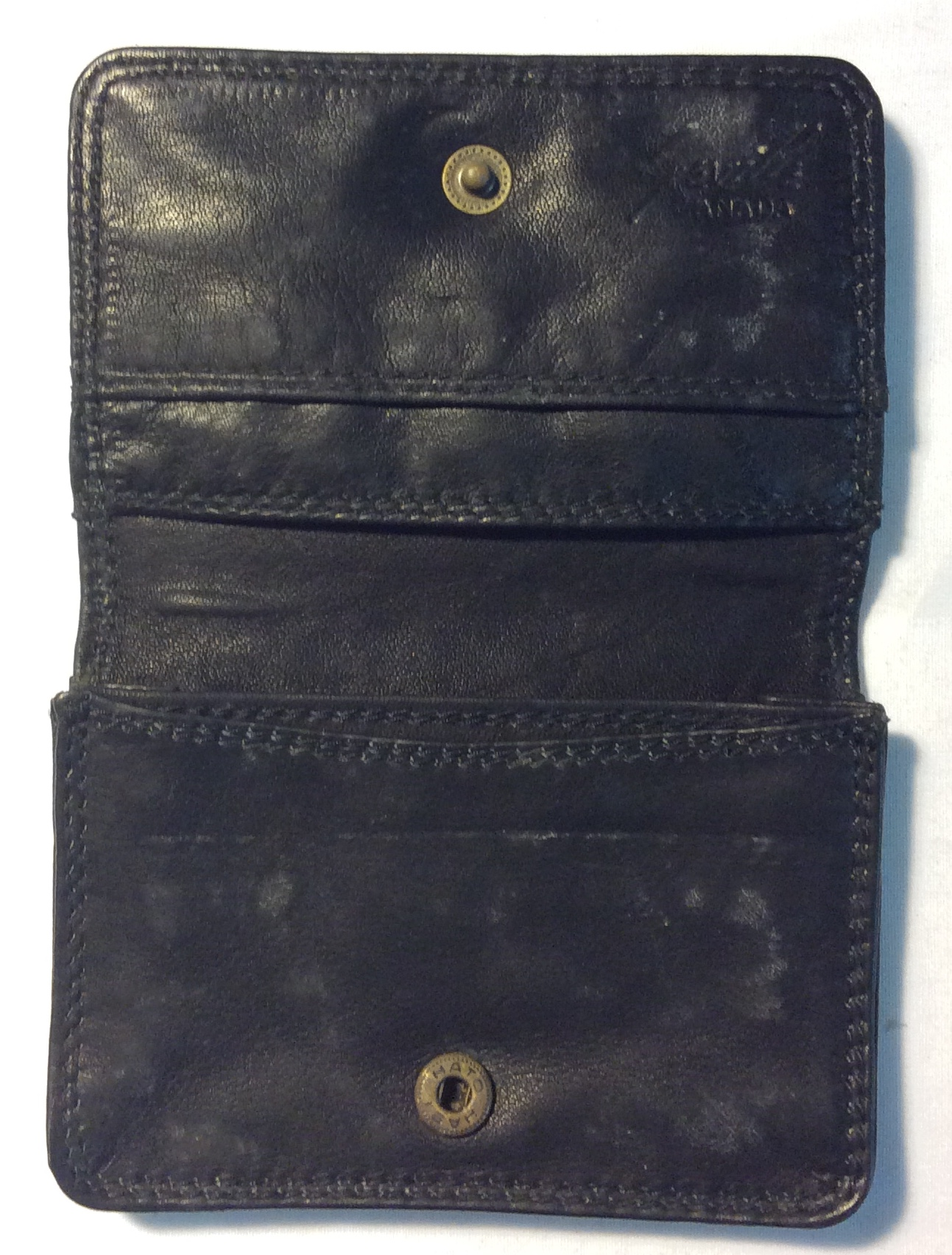 Black leather card holder with brass