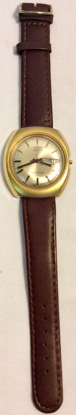 Timex Dynabeat Aged golden face with brown leather strap
