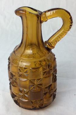 Miniature yellow glass pitcher