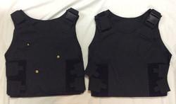 Black kevlar vest with adjustable