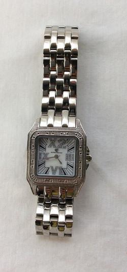Super Techno. Roman numerals glittery watch with silver band.