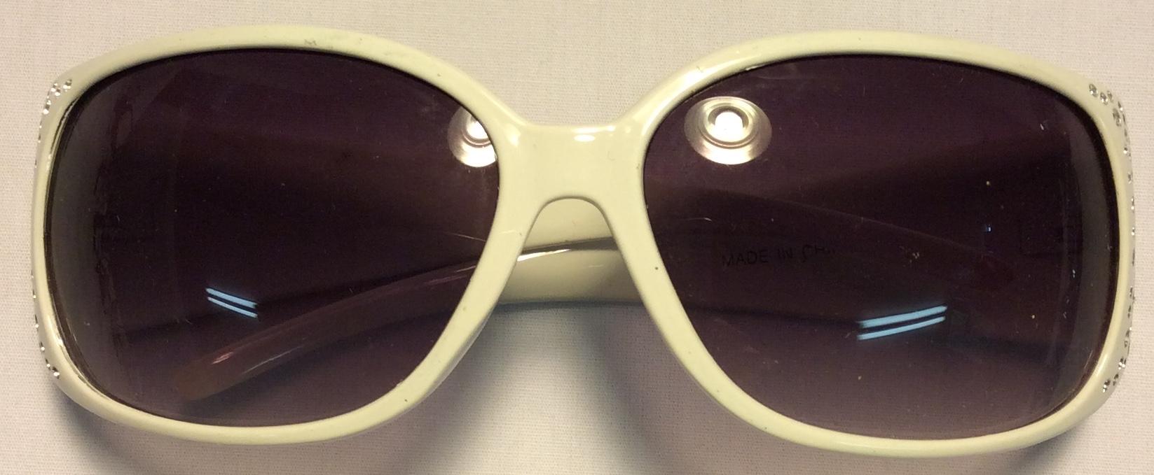 Thick white plastic frames