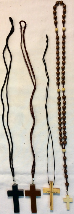 Assorted wooden rosaries and cross necklaces