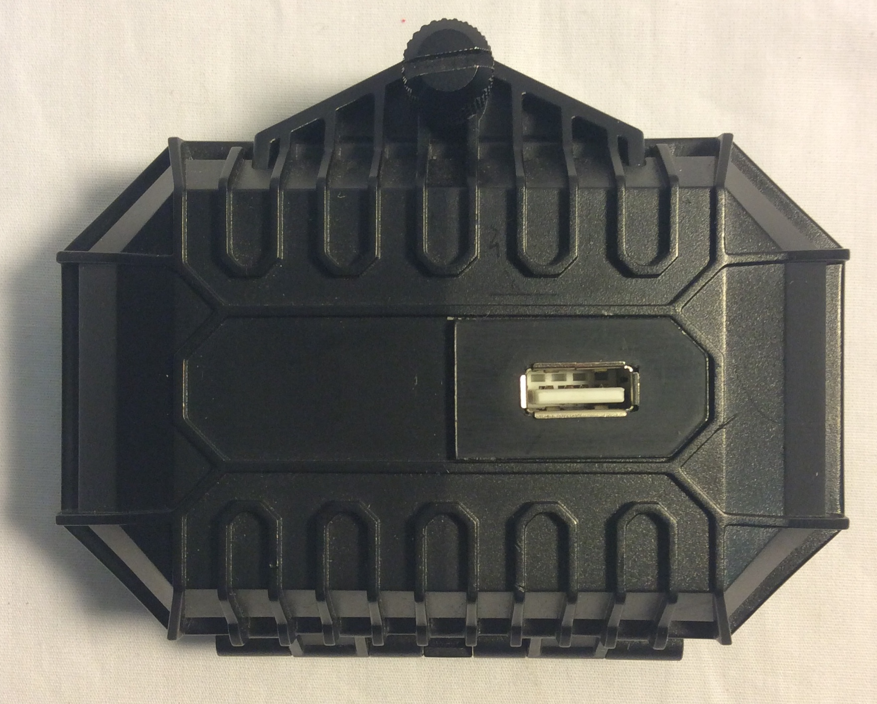 Black plastic box with USB plug