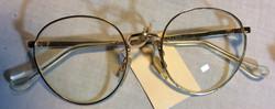 Large gold framed period eyeglasses