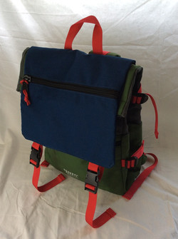 General supply outdoorsy school bag. Blue and green with red straps