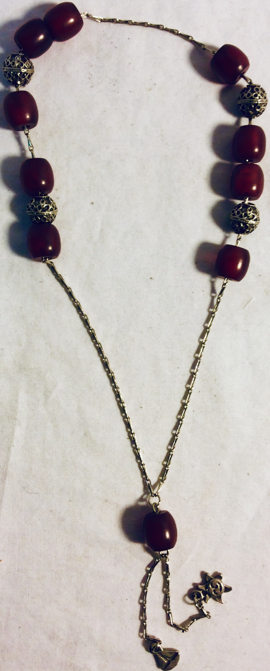Praying bids in silver and burgundy beads