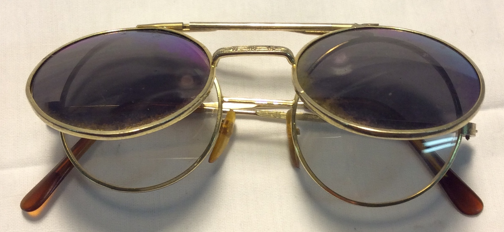 Gold frames, light brown ends, green