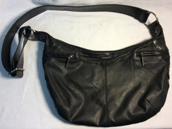 Small black purse with crocodile pattern on the strap