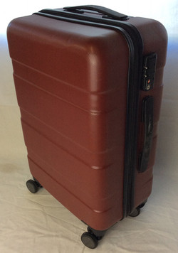 Small vintage burgundy hard-shell suitcase