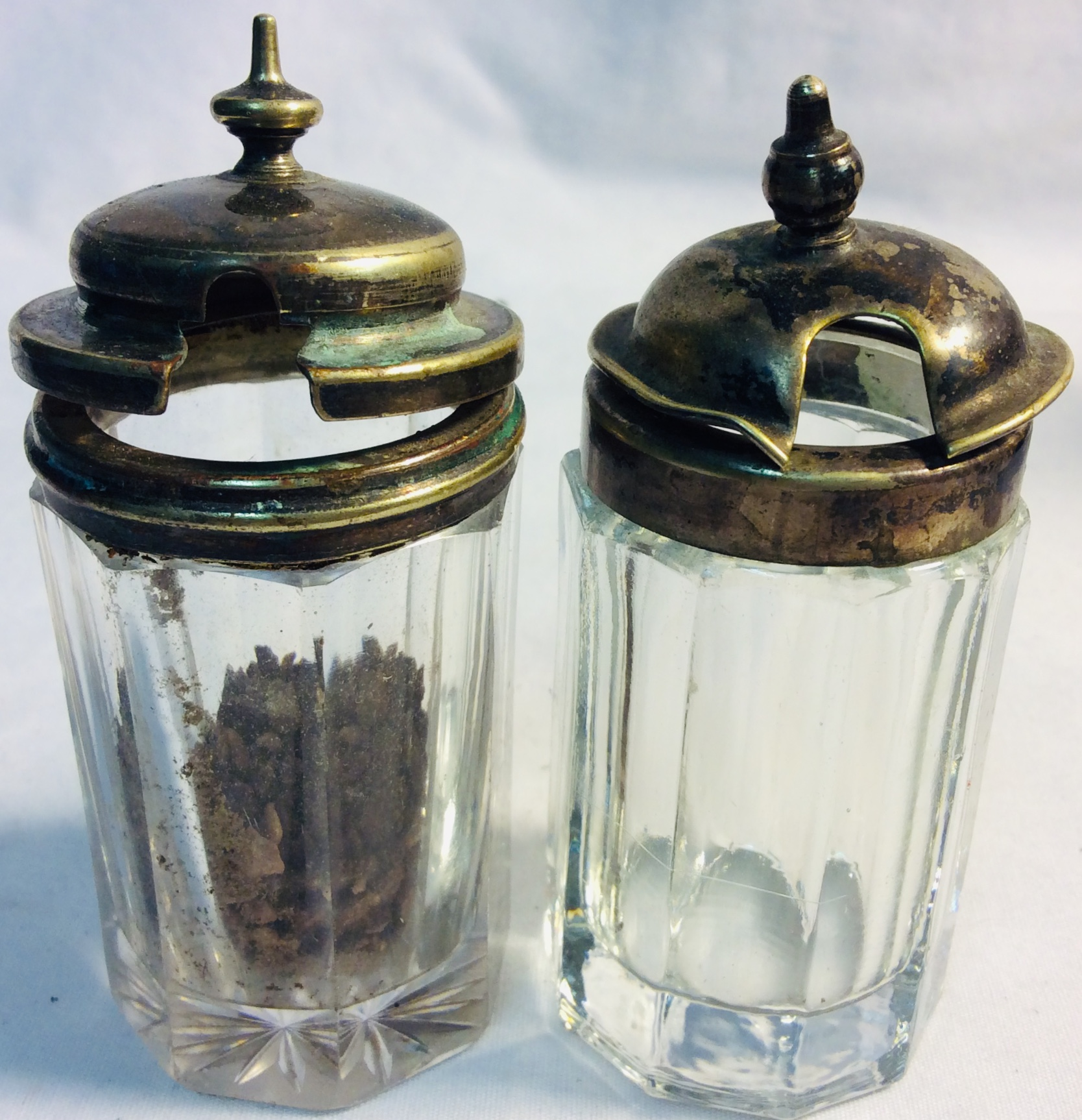 Small potion glass containers with aged metal lid