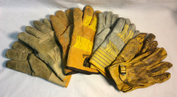 Assorted pairs of yellow leather work gloves