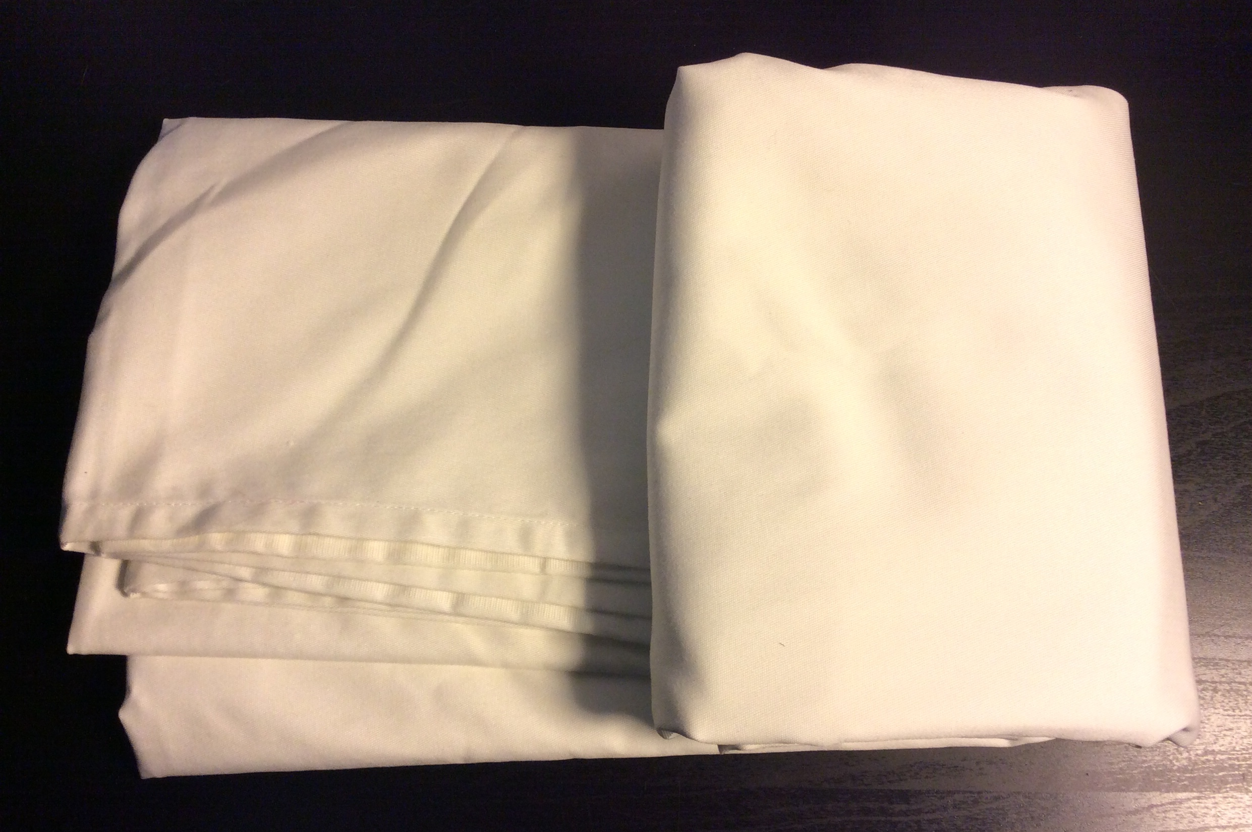 "White rectangular tablecloth 96""x 58"