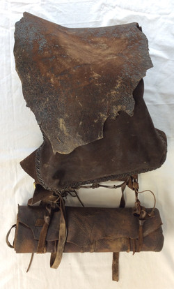 1800's rough style leather backpack with bedroll.