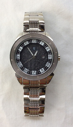 Super Techno. Beefy silver watch with metal band and bedazzled interface