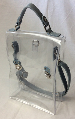 Clear plastic purse/shoulder bag with grey leather straps.