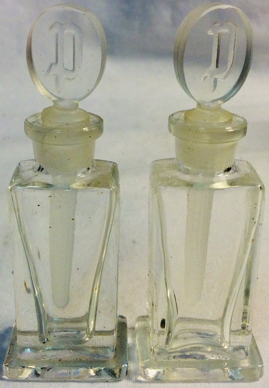 "Small perfume glass bottle with ""P"" on the lid"