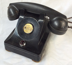 Black rotary dial home phone without dial, numbers.