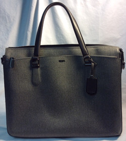 Tumi Heathered Grey with brown handles, PVC material
