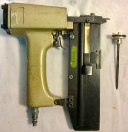 Vintage nail gun with black case