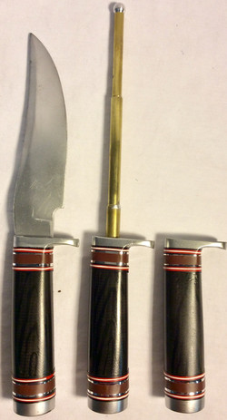 Knife with faux dark wood, silver and red details. x1 rubber x2 VFX x1 handle only
