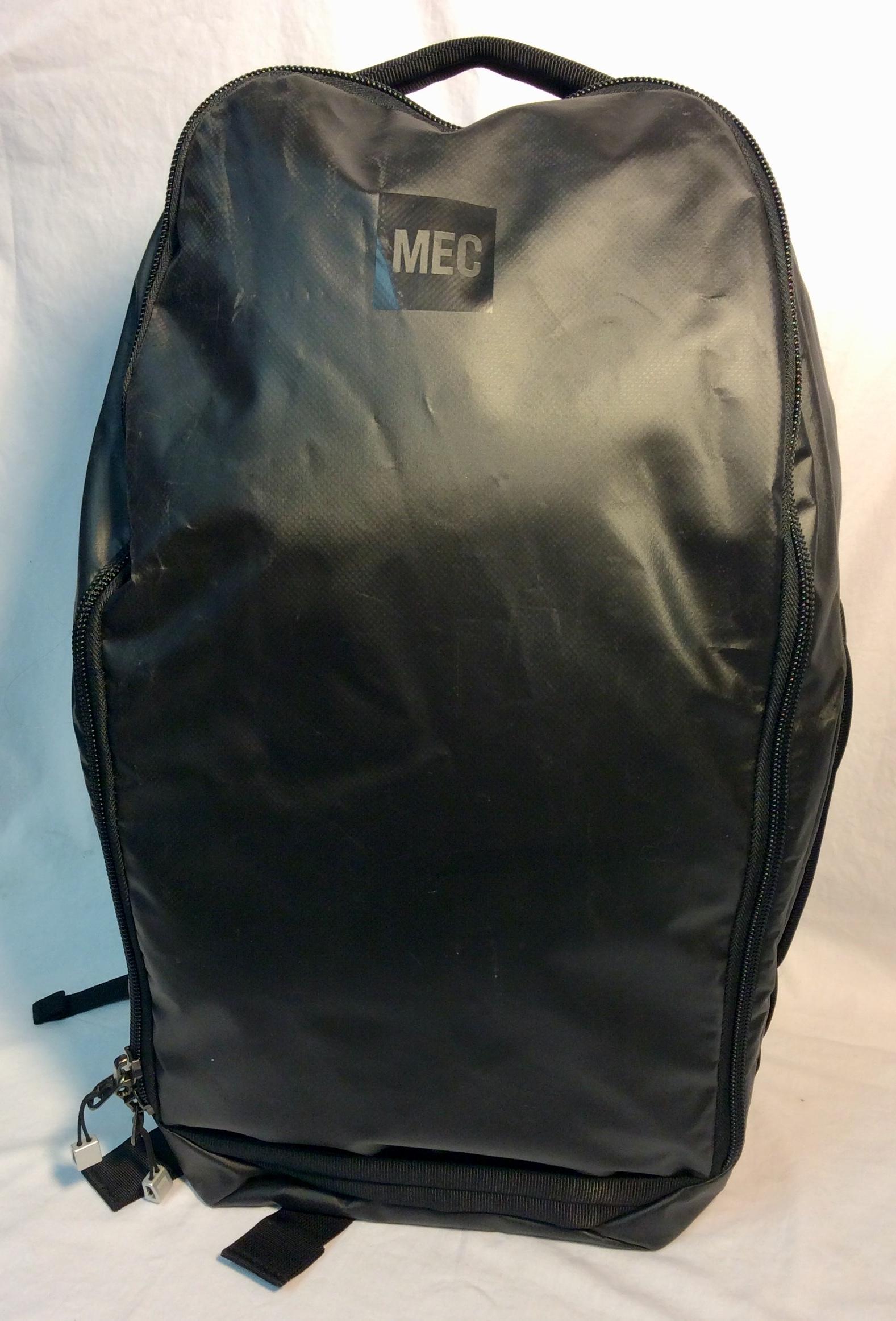Black vinyl MEC Outpost Pack bag