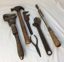 Various rusty vintage hand-tools.