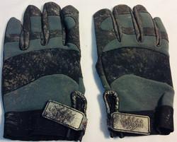 Pair of aged dark grey gloves