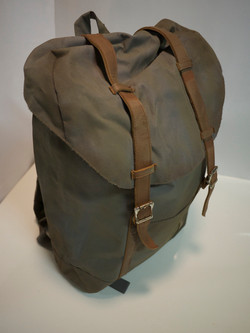 Grey backpack with brown straps