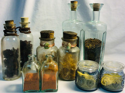 Assorted sizes and shapes potion glass bottles