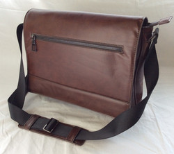 Dark brown leather satchel. Zipper on inside and outside pockets.