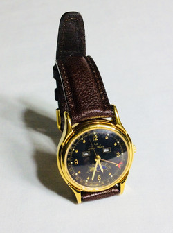 LA watch with red moon