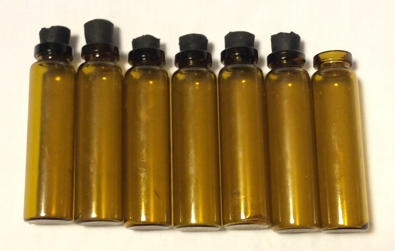 Small brown glass vials with black