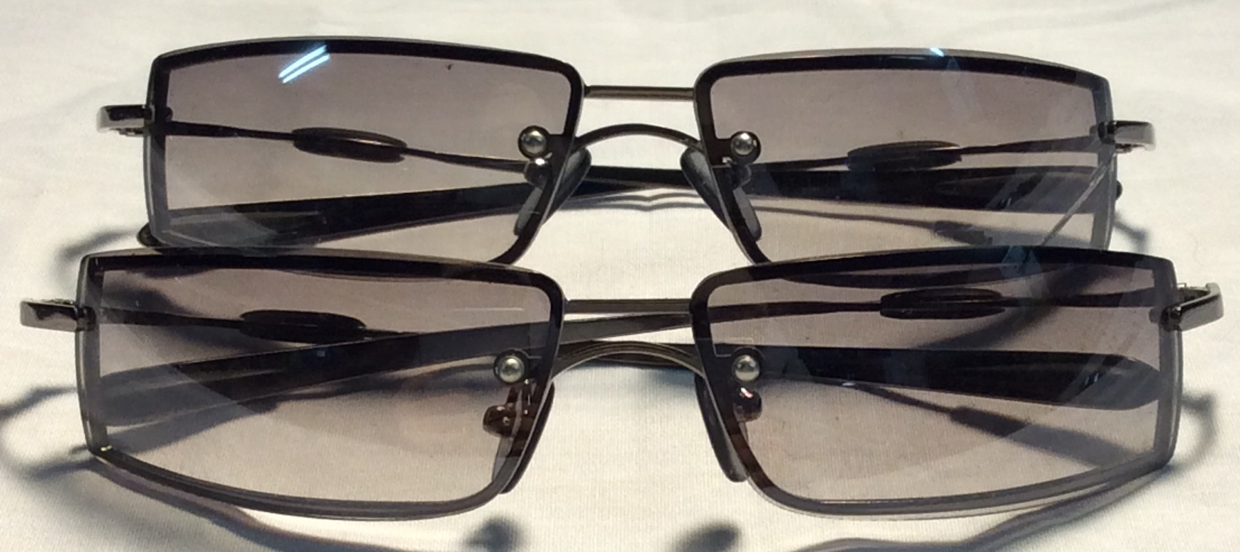 Silver metal frames, black rubber