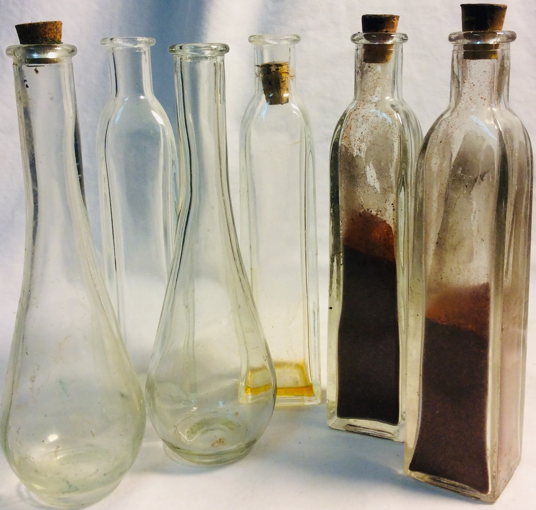 Assorted tall glass bottles