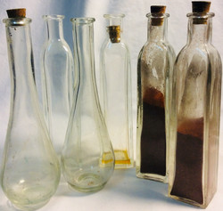 Assorted tall glass bottles