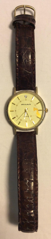 Milan watch - round gold face