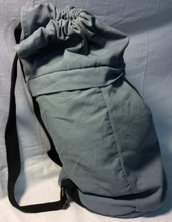 Light blue fabric drawstring top bag