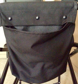 Pouche for cast chair. All black, canvas with metal attachment.
