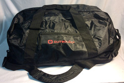 """Black vinyl bag with red """"Outbound"""""""