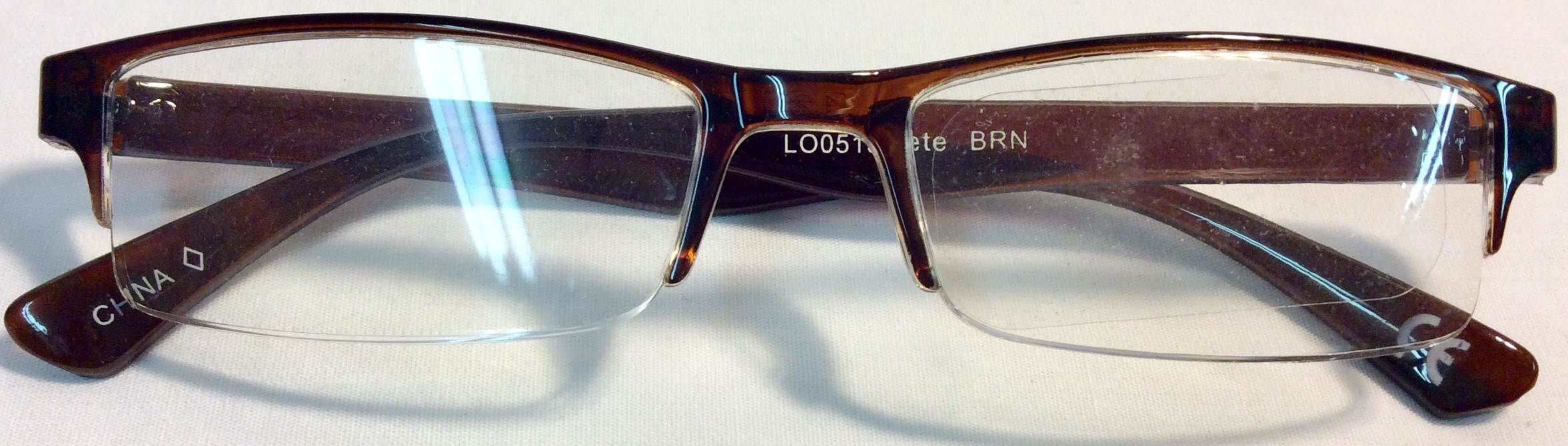 Reading glasses with half brown frame