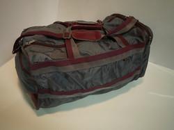 Grey and burgundy duffle bag