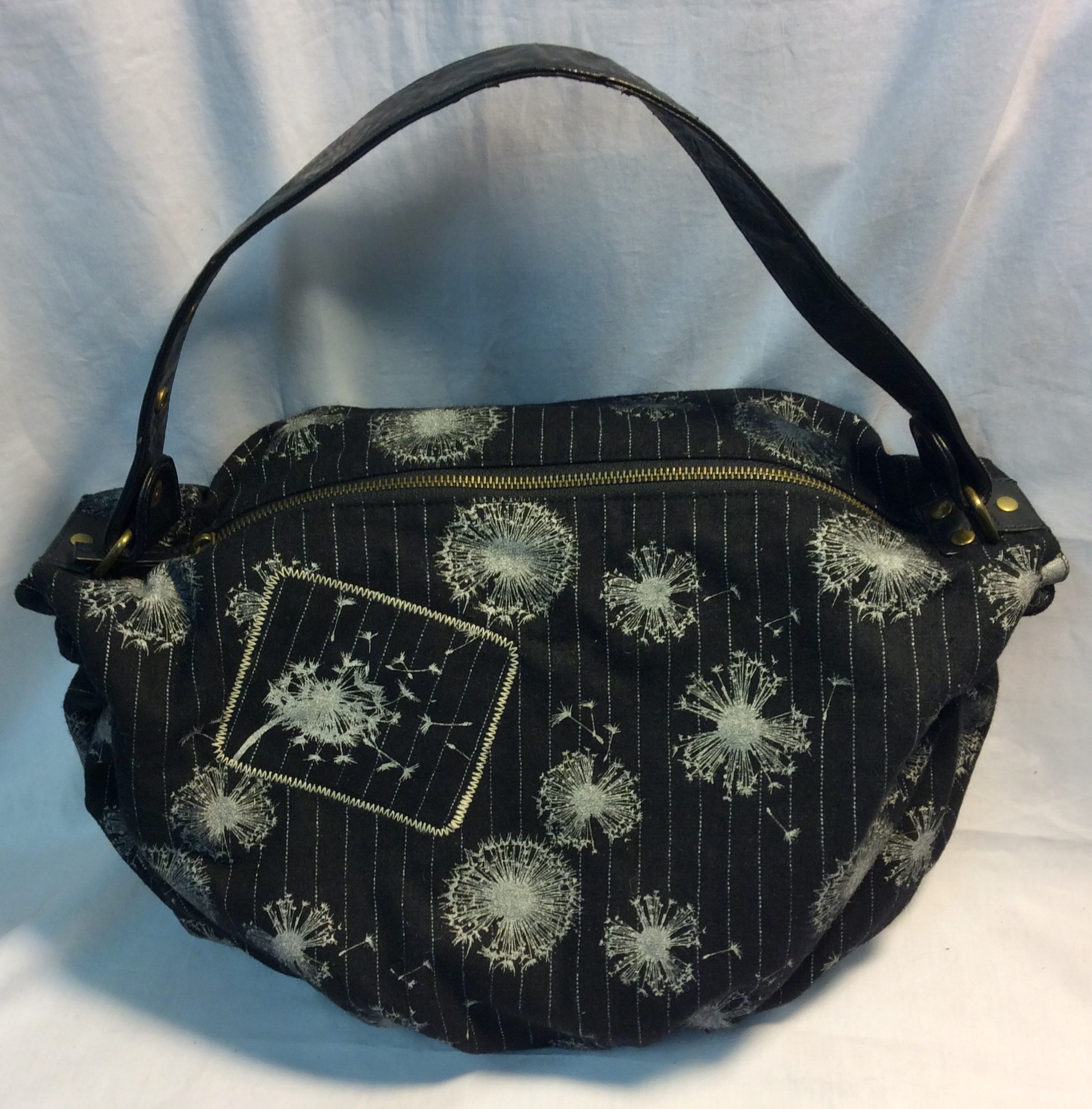 Black purse with white flowers
