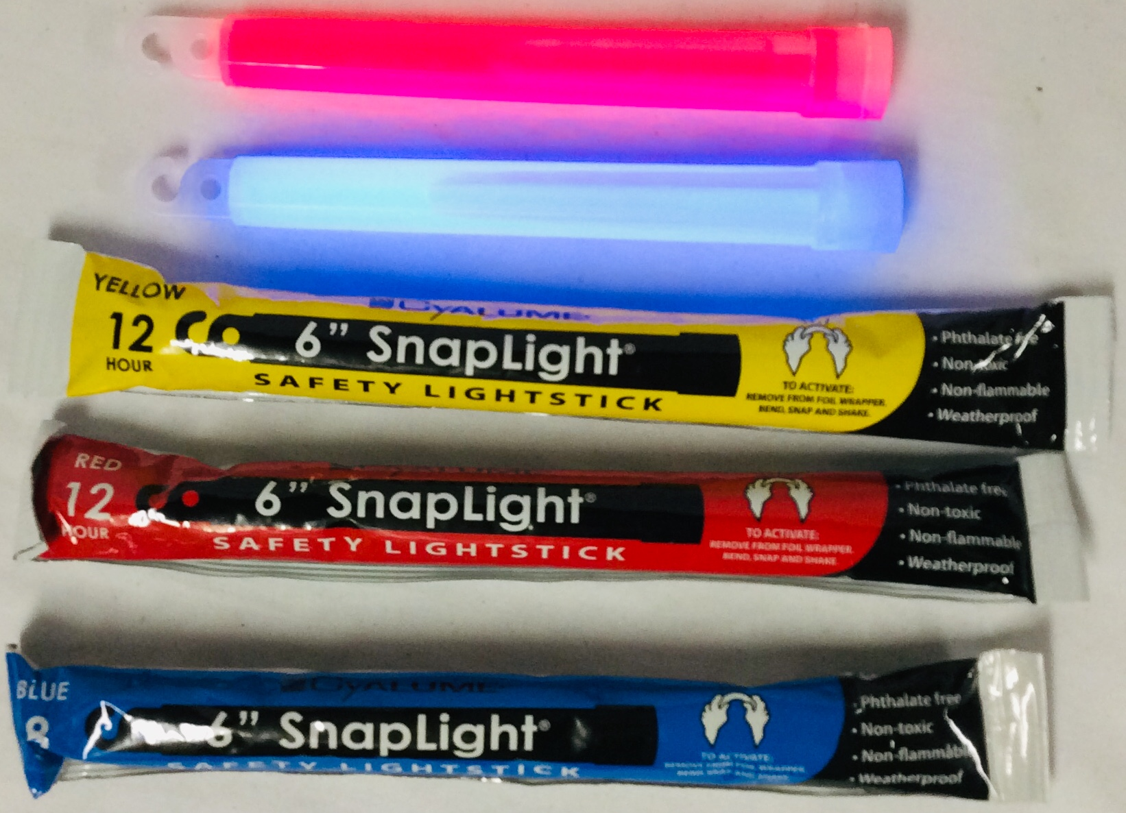 Box with multiple glow sticks/snap lights in yellow, red and blue