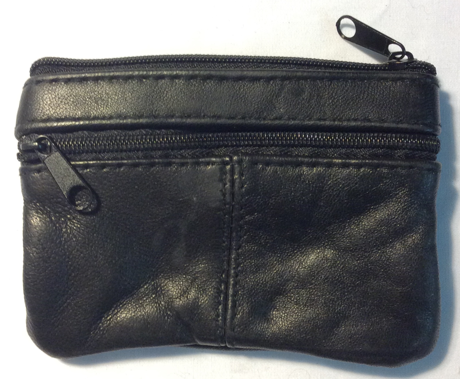 Black worn leather with 3 zippered