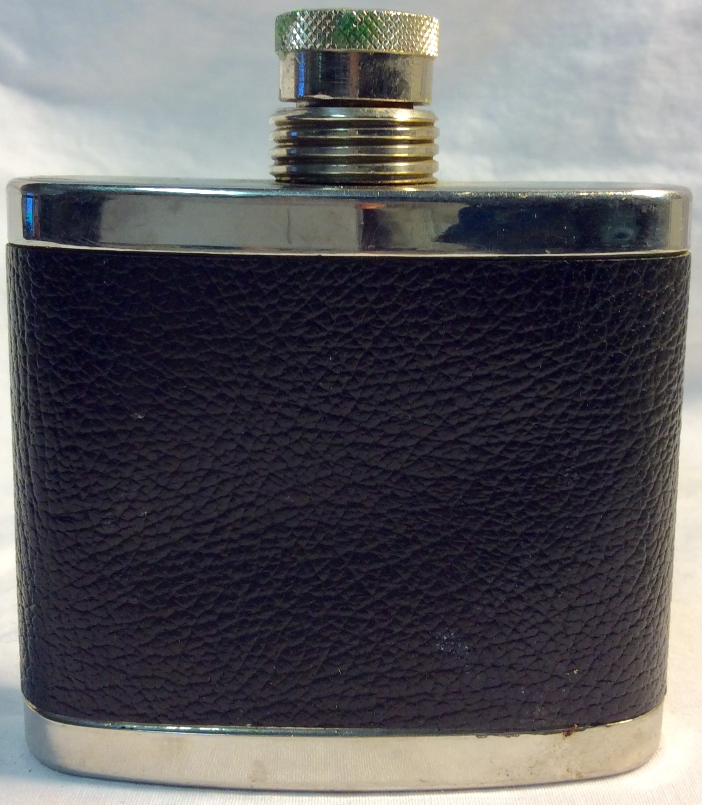 5oz silver flax with black leather cover