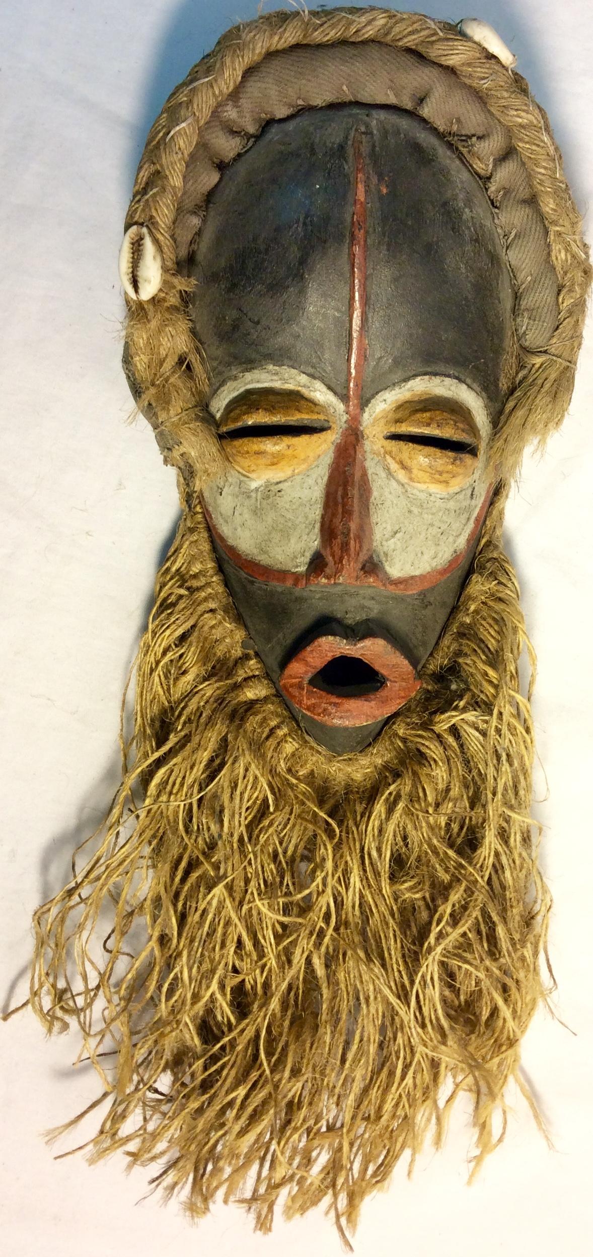 Tradicional african mask. Wood and raffia