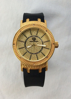 Super Techno gold and jewled watch with black rubber band.